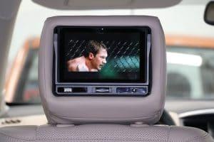 Lecteur dvd portable intégré à l'appuie tête du conducteur